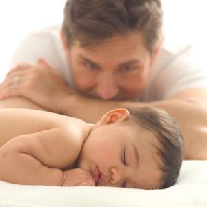 Father Watching His Infant Sleep