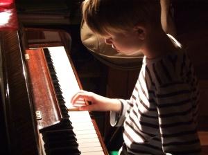 PianoKidPlaying